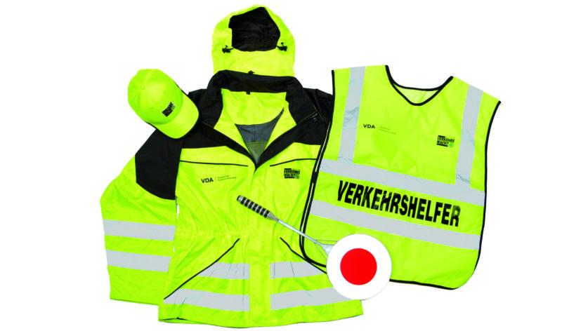 Schülerlotsen Verkehrshelfer Ausrüstung Kappe Überwurf Kelle Lotsenkelle